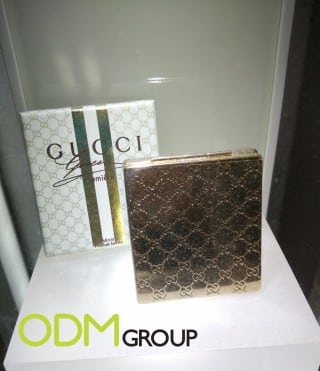 Promotional compact mirror as a GWP by Gucci