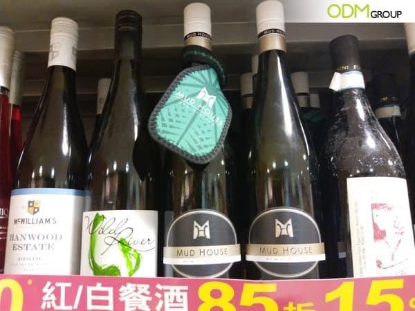 Unique Bottle Necker Idea by Mud House: GWP Luggage Tag