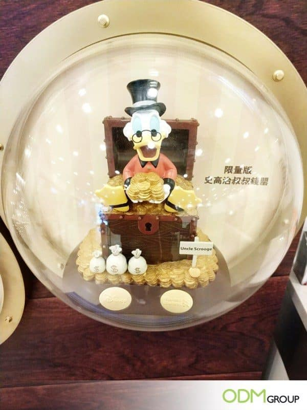 Custom Piggy Banks by Disneyland HK & Standard Chartered